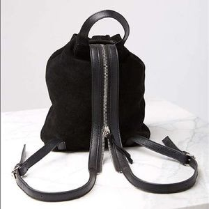 Urban Outfitters Drawstring Suede Mini Backpack